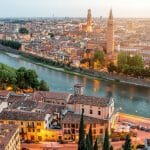 Verona panoramic aerial view on illuminated old town on the sunset in Italy
